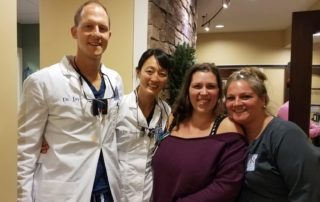 Raynor Dental Staff with Patient on Free Dental Day